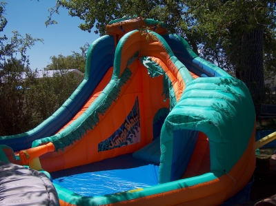 The right water slide is curved and partly covered at the bottom