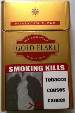Front of a Gold Flake Kings box, sold in India, displaying the old pictorial warning