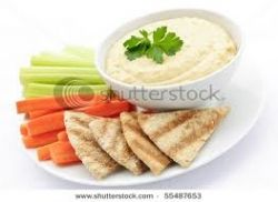 Hummus with pita bread and veggies