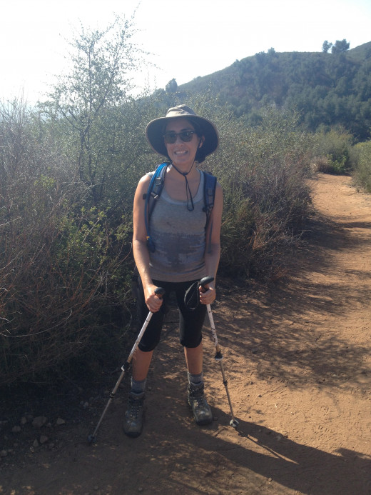 For comparison, this is me on that hiking trip. I'm sweaty and wearing a horrible hat. I'm smiling, but I'm totally faking it.