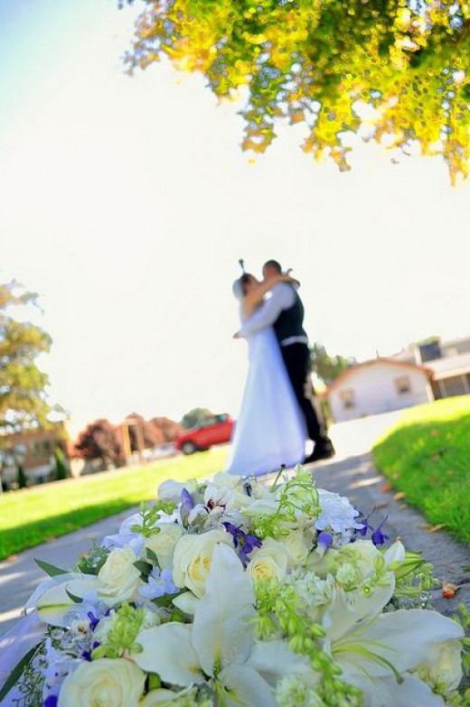 The Bride and Groom with the Bouquet
