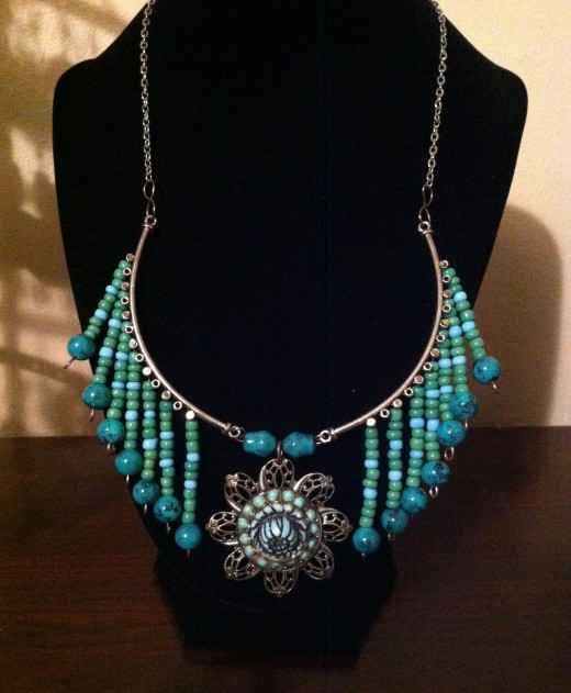 Vintage inspirations, the pendant in the middle is a vintage piece, repurposed and upcycled beauty!