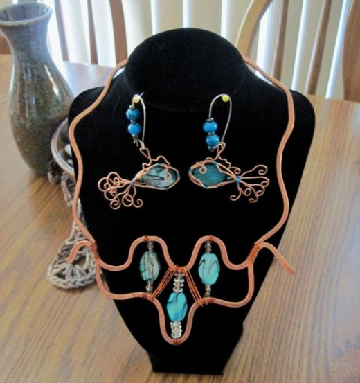 Copper hammered wire with teal blue green shell fish earrings to match