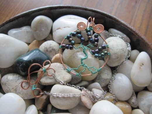 Copper tree of life with hues of blues, purples and greens