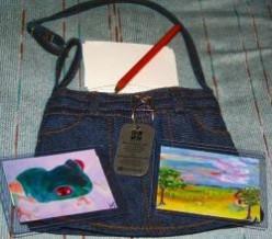 Lindas Traveling Art Show Geocache Travelbug
