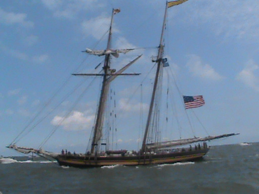 The Pride of Baltimore II sails beside us as we head out to catch up to the larger ships and take the lead.