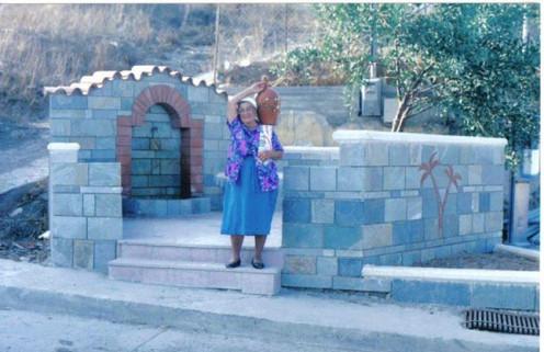 Village women still carry water urns on their shoulders.