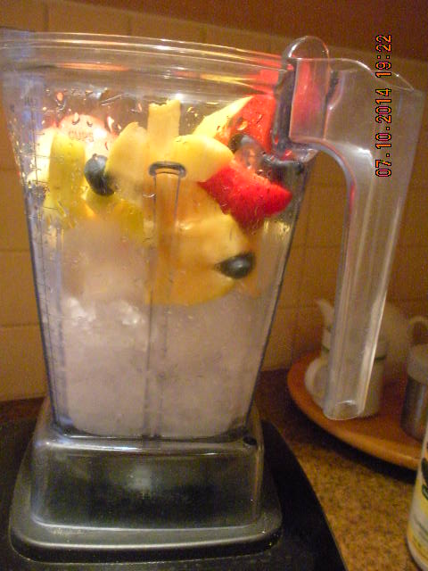 After ice is crushed dump fruit on top & mix