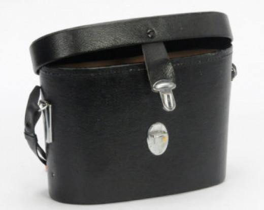 an old camera, binoculars case or Doctor bag. Doctor Bag #1