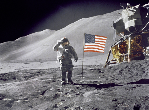 "Apollo 15 Commander Dave Scott salutes the American flag at the the Hadley-Apennine lunar landing site. The Lunar Module ""Falcon"" is partially visible on the right. Image Credit: NASA"