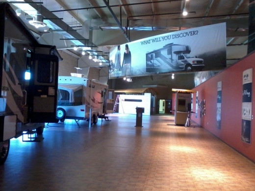 Inside the Go RVing display hall. There is a theater where RV videos play, and some new recreational vehicles as well.And...there are displays explaining the benefits of the different types of RVs. I can keep Class A and fifth wheel straight. The o