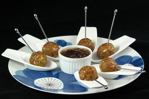 Chicken Delights appetizers with chutney for dipping
