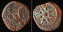 A bronze Widow's Mite or Prutah, minted by Alexander Jannaeus, King of Judaea, 103 - 76 B.C. obverse: anchor upside-down in circle, reverse: star of eight rays From the private collection of Randy Benzie