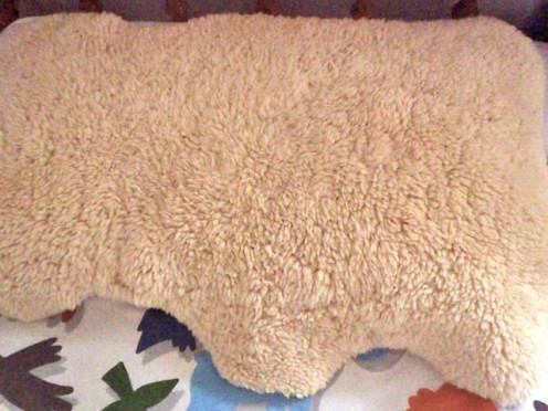 Here's mine you can see that it's not fluffy any more. It's on my son's pillow and he sleeps on it every night. It's just as useful now.