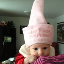My baby in her Christmas elf hat. This was a clothing gift that was just pure simple fun.