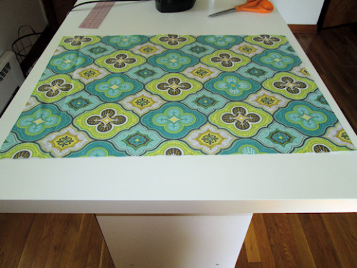 Here is the fabric cut and ready to be adhered to the board.