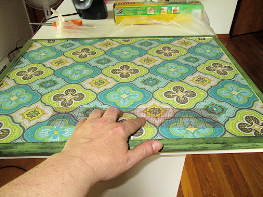 I laid the fabric at the bottom edge first and worked my way up. I used my trusty ruler to push out any bubbles working from the bottom to the top.
