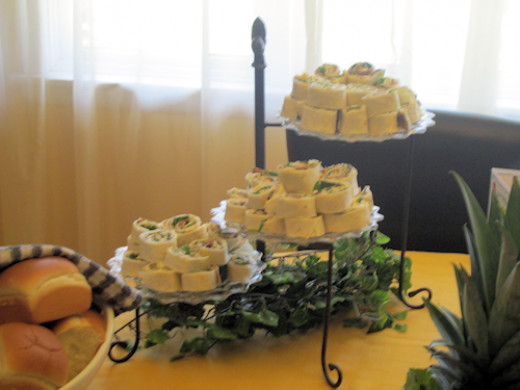 Pinwheels on a spring buffet. I used clear Fostoria plates here. Note the greenery at the base of the 3 tiered stand.