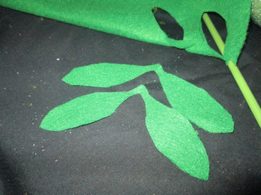 Open the leaves and you will get the idea of how you will wrap the leaf around the painted dowel rod.