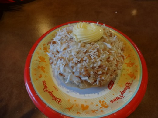 Dessert from the Country of Norway -  School Bread: Sweet cardamom bun filled with vanilla creme custard and topped with glazed and toasted coconut