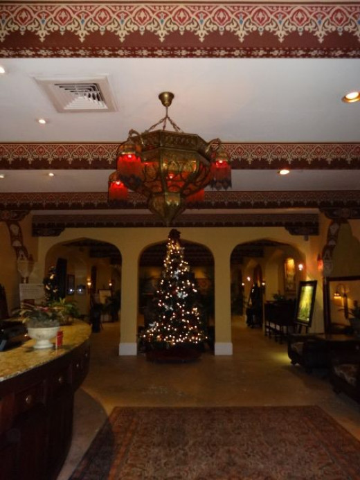 Casa Monica clothed for Christmas in the hotel front desk and lobby area