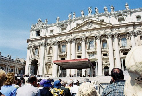 Pope John Paul II giving an audience, under the canopy.
