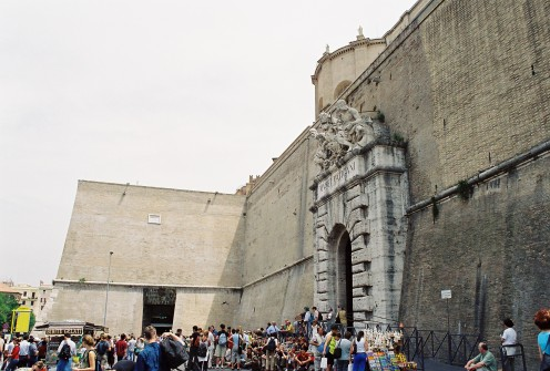 "The entrance and exit to the Vatican Museums. The wall is the ""border"" between Italy and the Vatican City."