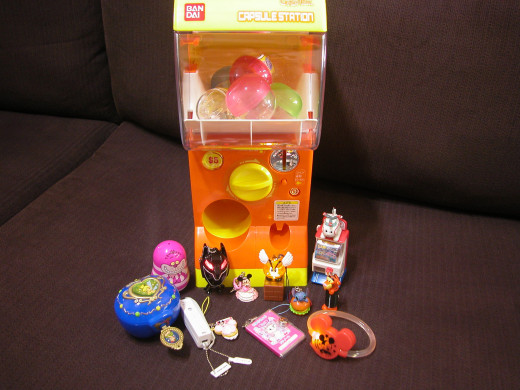 My personal Gacha Machine! It's about 33% of regular size Machine, along with those cutie toys!