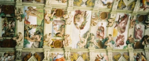 "Along the middle of the ceiling - the famous ""God and Adam touching fingers"" section is in the center. (tilt your head to the left to see it better.)"