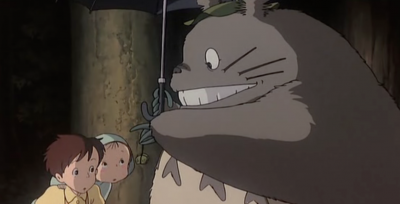 Totoro giving them a present =) I want one too!