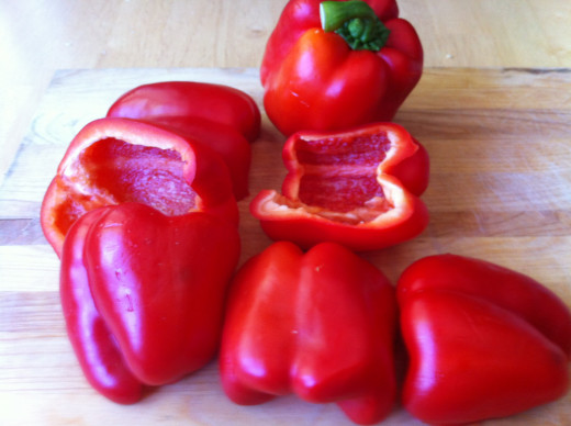 cut sweet red peppers ready to be roasted