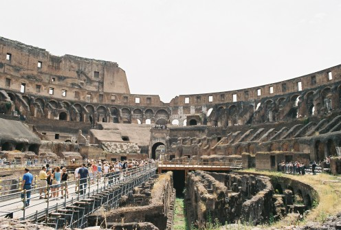 """Inside the Colosseum. The original floor is now gone, so you can see directly down into the lower chambers. The white marble area in the top-center of the stands is where the emperor would sit during the """"games""""."""