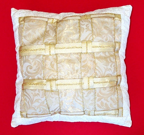 Ivory and Gold Ribbon Pillow with fabric border.
