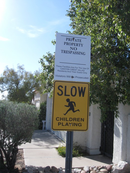Sign at entrance to a Townhouse development with a Homeowners Association