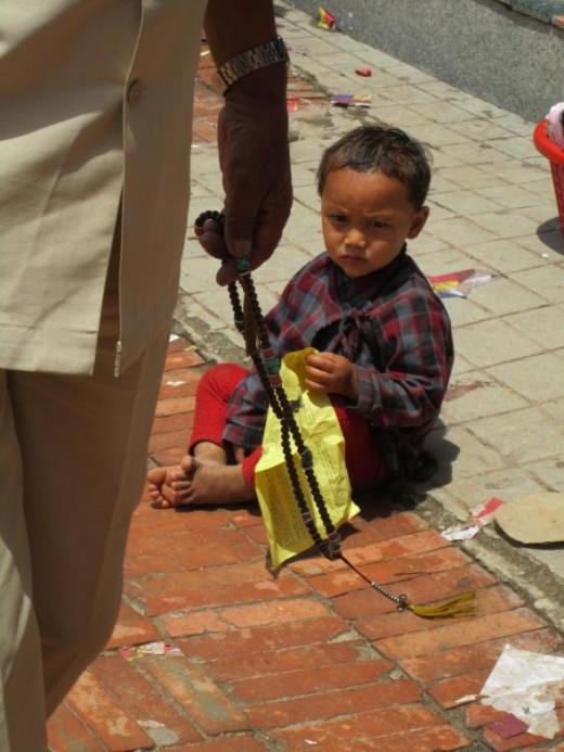 A little boy at Boudha Stupa, Kathmandu, Nepal