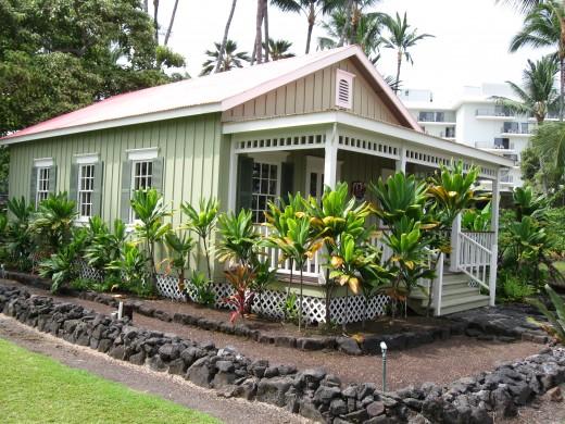 Full size replica of Kalakaua Cottage one of two beach homes owned by Hawaiian King David Kalakaua on the Island of Hawaii next to Kahaluu Beach Park