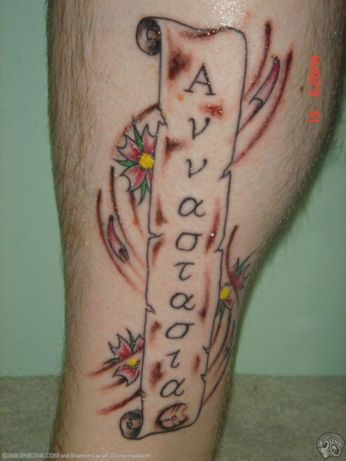 "(GAME: ""Find the Bad Apostrophe in the Tattoo"") ""Love never fails""."