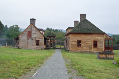 The Great Hall (right) at Grand Portage and the kitchen (left) out back