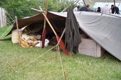 Voyageurs usually stored their gear and slept beneath oilcloth lashed to their upturned canoes.