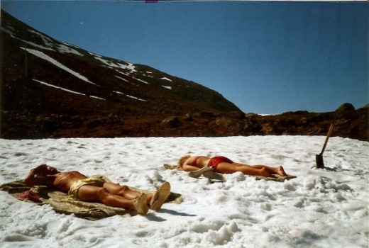 Only in Norway.  Two of my good friends sunbathing.  On top of a sheet of snow.  In June.  What a wonderful place!