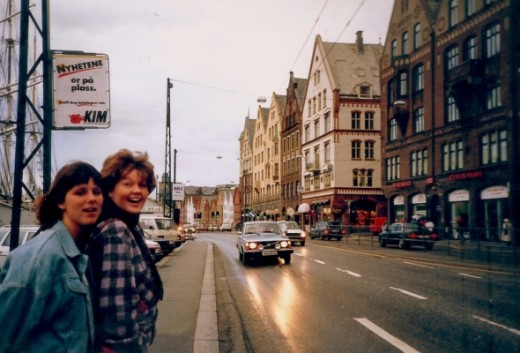On the streets of Bergen, Norway.  The famous Bryggen buildings are on the right side (A World Cultural Heritage Site).