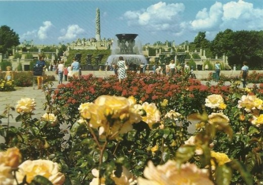 A postcard showing the fountain and the monolith behind.
