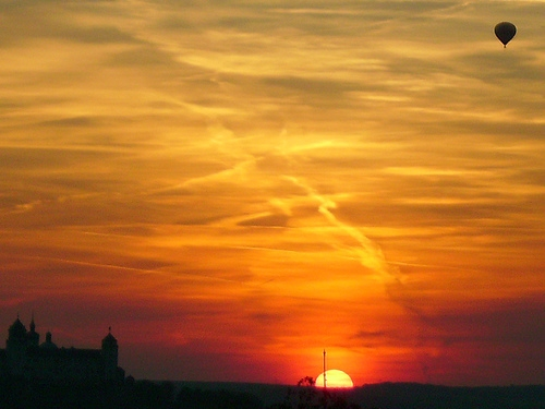 A beautiful sunset once inspired me to write a poem.   Image:  sunset balloon flight by Axel-D on Flickr Creative Commons