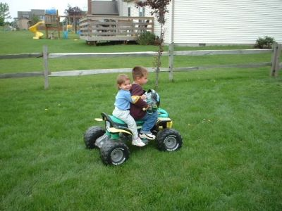 My Son giving my Daughter a Ride on his Quad