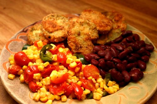 farmer's dinner with fried green tomatoes, seasoned kidney beans, and a side of jalapeno corn with garden cherry tomatoes