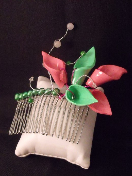 A hair comb decorated with polymer clay Cala Lilies