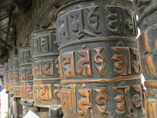 "The Buddhist prayer wheels. The mantra ""Om Mani Padme Hum'' is inscribed in the wheel."