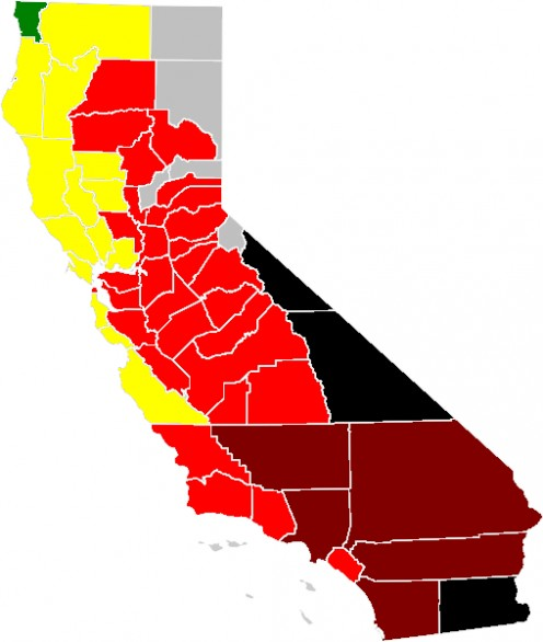 Red signifies that the county experiences at least one unhealthy (85+ PPM) day per year, Dark red (200+ PPM a year), Black (300+ PPM a year).  Black means forest wildfires occurred that year.