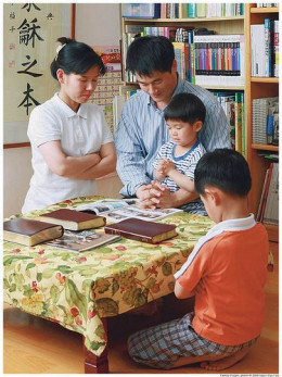 Praying Family by More Good Foundation/ flickr