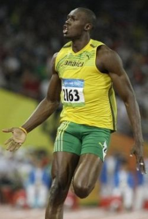 Usain Bolt finishing a race in triumph